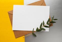 postcard mockup. blank white card with kraft brown paper envelope