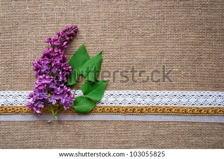 postcard with lilac and handmade ribbons on sacking cloth