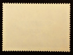 Posted stamp reverse  side with the edge of the sheet. Texture of paper.