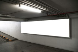 poster billboard in underground parking lot,empty poster template for business advertising.