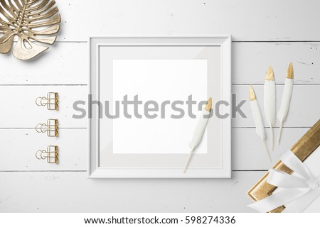 Poster frame mockup square size, top view, with decor elements, feather, flowers and blank copy space on white background. #598274336