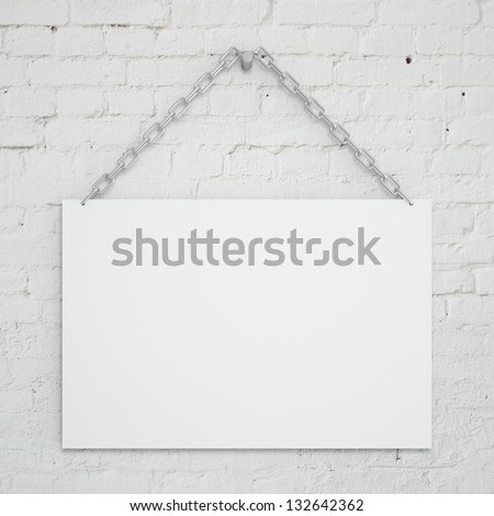 poster hanging on a chain on wall