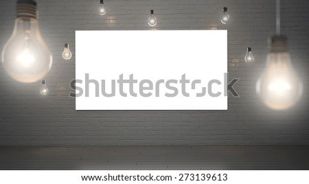 poster in a brick loft ceiling lights