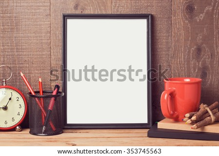 Poster mock up template with business desk objects over wooden background