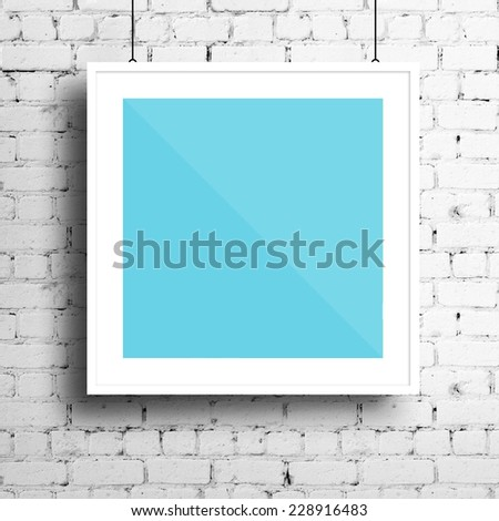 Poster mockup template with white square frame on brick wall #228916483