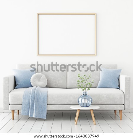 Poster mockup with horizontal frame hanging on the wall in living room interior with sofa, blue plaid and green branches in vase on empty white background. 3D rendering, illustration. Photo stock ©