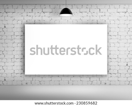 poster on brick wall with lamp