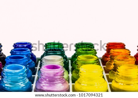 Poster paint is a distemper paint that usually uses a type of gum water or glue size as its binder. It is normally a cheap paint used in theatrical backdrops or in grade school art classes.