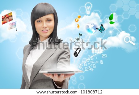 Poster portrait of young beautiful woman holding her universal device - tablet pc. Lots of things are appearing from the display. Universality of modern devices concept