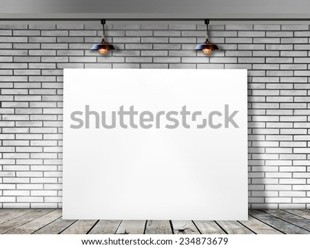 Poster standing in White Brick wall with Ceiling lamp