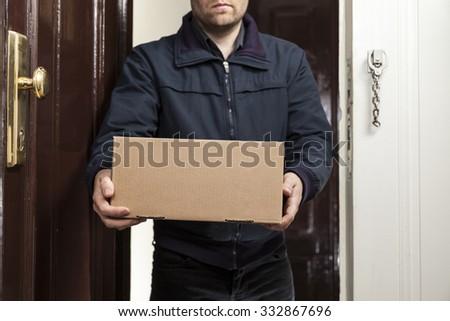 Postman delivers parcel