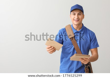 Postman with letters on light background Stockfoto ©