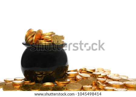 Pot of gold filled with gold coins piled high and spilling over, isolated on white background. Fun Saint Patricks Day theme.