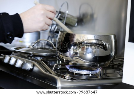 pot on the stove with a ladle