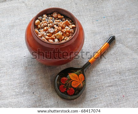 Pot with porridge which is prepared in eve Christmas from a wheat, nuts, apples, raisin and honey