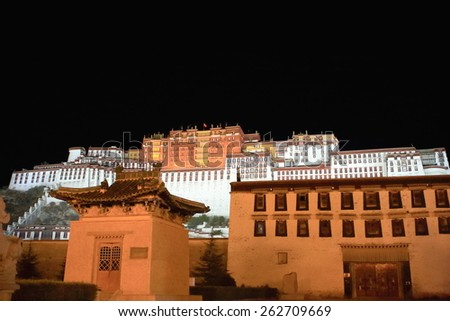 Potala palace at night with the Potrang Karpo-White Palace to the East and the Potrang Marpo-Red Palace to the west at 3700 ms.high over Marpo Ri-hill overlooking Lhasa town. Tibet A.R.-China.