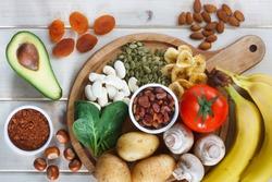Potassium Food Sources as dried apricots, raisins, avocado, cocoa, bean, pumpkin seeds, dried banana, potatoes, tomatoes, spinach, mushrooms, fresh banana, hazelnuts, almonds.