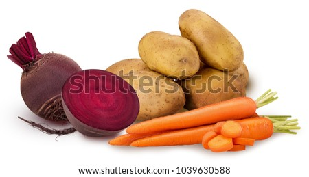 potato and carrot ring chopped, one red beet root, one cut in half isolated on white background. Clipping Path. Full depth of field.