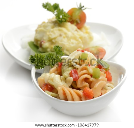 Potato And Macaroni Salad In White Dishes