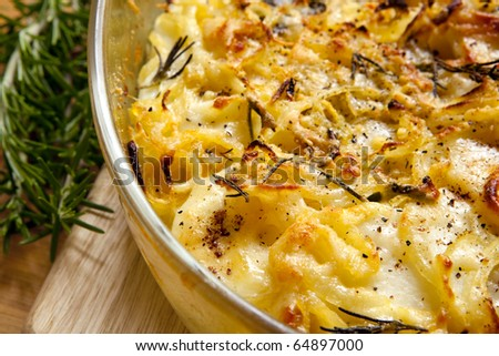 Potato and onion gratin, with rosemary.