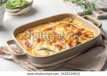Photo of  potato casserole with cream, gratin dauphinois, french cuisine