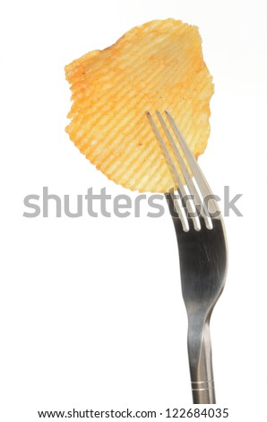 Potato chip on a fork isolated on white background
