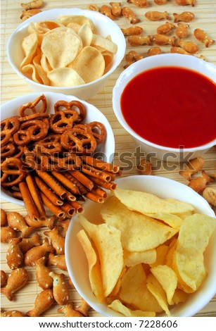 Potato chips and other snacks with salsa dip sauce
