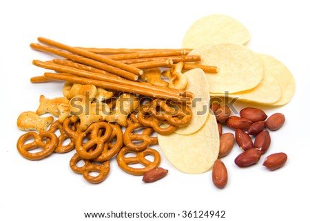 Potato chips and salty snacks isolated on white background
