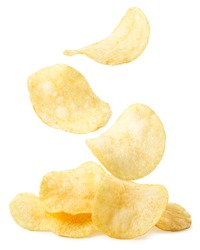 Potato chips are falling on a heap on a white background. Isolated