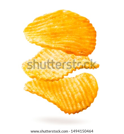 Potato chips are fluted falling on a white, isolated.