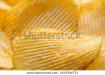 Potato chips background. Close-up photo. Food template for design