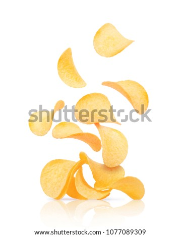 Potato chips fall on a heap with chips isolated on a white background