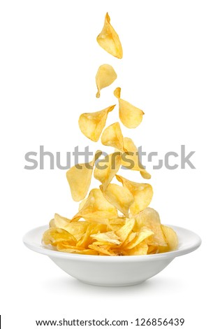 Shutterstock Potato chips falling in the plate. Isolated on white background