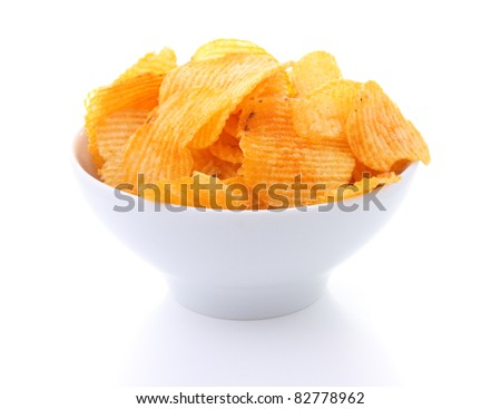 Potato chips in white bowl isolated - stock photo