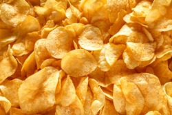 Potato chips or crisps .Potato chips texture background flat overhead view.concept of fast food and snacks. Food background.
