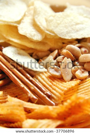 Potato chips, peanuts and salted sticks