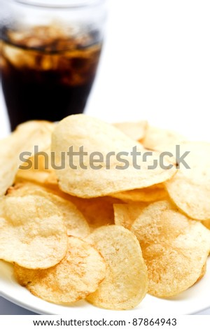 Potato chips with soda on white background