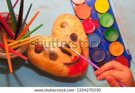 potato face painted with watercolors. Kids' games. Tubercle with heart shape. Pictorial manuals. #1204270330
