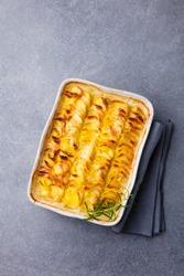 Potato gratin, backed potato slices with creamy sauce. Top view.