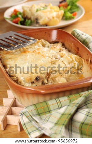Potato gratin with mushrooms, eggs, cheese and mixed greens