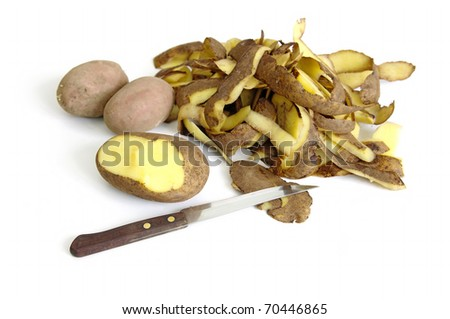 Potato, knife and potato peel isolated on the white background - stock photo
