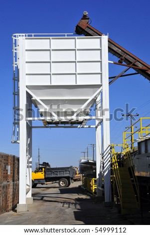 Potato packing plant: Potatoes are conveyed into hopper for loading onto truck