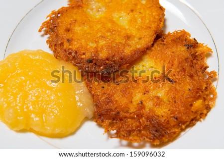 potato pancake with apple sauce  - stock photo