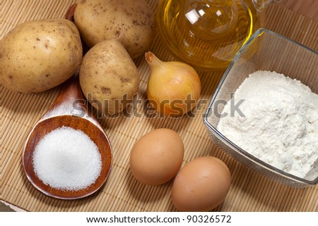 Potato pancakes ingredients and olive oil for a frying