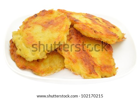 Potato pancakes on a plate isolated on white background