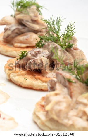 potato pancakes on plate with with mushrooms and dill