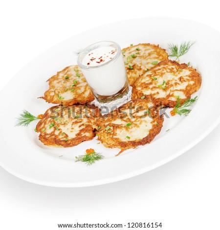 potato pancakes with smoked salmon and sour cream. isolated on white background