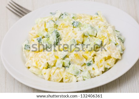 Potato salad with onions and cucumber with a mayonnaise-cream dressing