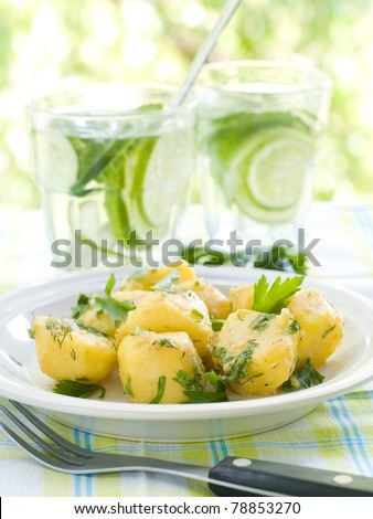 Potato salad with parsley and olive oil. Selective focus
