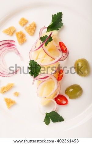 Potato salad with red onion, olives and parsley